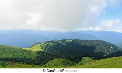 Wooded hill in the mountains. Panorama. TimeLapse. Sochi,...