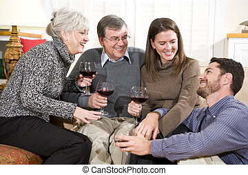 Mid-adult and senior couples enjoying conversation and wine