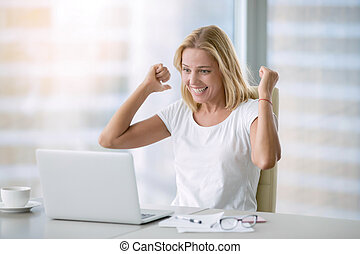Young happy woman with laptop - Young happy attractive woman...