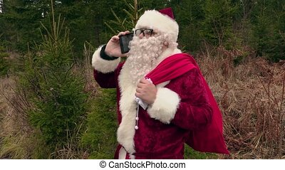 Santa Claus talking on phone and laughing