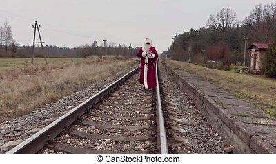 Santa Claus walking on railway