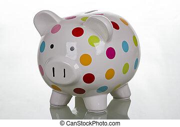 White polka dot piggy bank