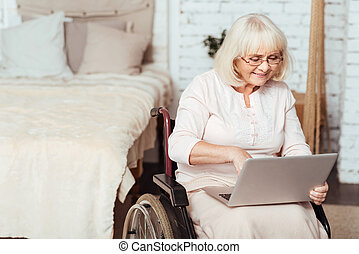 Positive disabled woman surfing the Internet