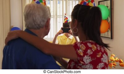 Child Taking Photo Of Happy Mom And Grandpa Dancing