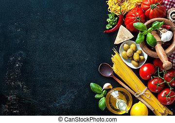 Italian food ingredients on slate background - Italian...