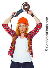 Female construction worker in a hard hat with angle grinder...