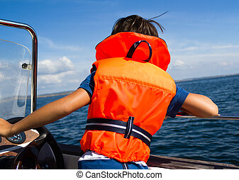 Child with life vest - Photograph of a young boy with a life...