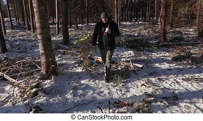 Lumberjack with ax in destroyed forest