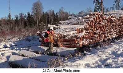 Lumberjack with rope across snow covered slope