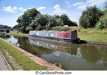 Barge moored beside canal,nearside tow path in...