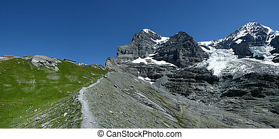 Eiger trail in Switzerland - Panorama with Eiger (3970 m)...