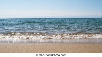 Waters of the lake Issyk-Kul in the background of mountains,...