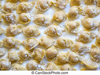 Raw italian cappelletti, fresh homemade pasta stuffed with...