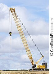 crawler crane - view of a yellow crane in a landscape of...