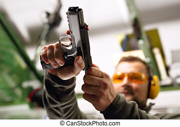 Sport shooting range - The man at the shooting reloads...