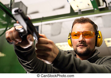 Shooting range - The man at the shooting reloads pistol