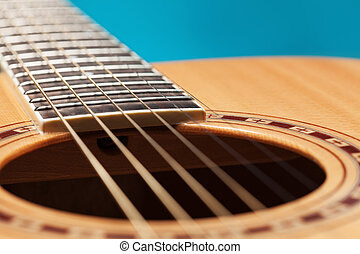Acoustic guitar upclose - Acoustic guitar on blue background...