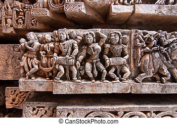 India - Stone sculpture of musicians at the ancient temple...