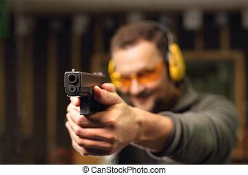 Shooting range - Shooting a gun at shooting range