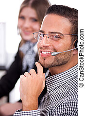 Attractive executive smiling with a collegue