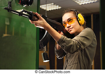 Shooting range. - The woman at the shooting range shot from...