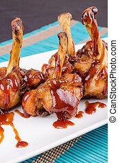 Drumsticks - Chicken drumsticks servew in BBQ sauce, a...