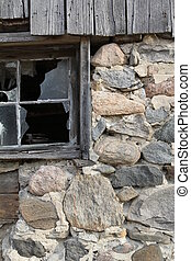 stone wall and window - detail of a natural fieldstone barn...