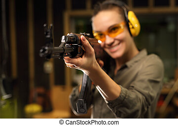 Sport shooting. - The woman at the shooting range shot from...