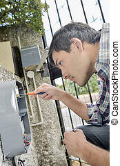 Electrician repairing an intercom system
