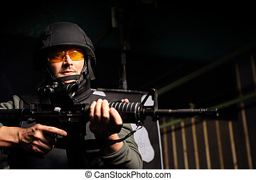 Cop shoots a rifle shooting range - A man in a vest shot at...