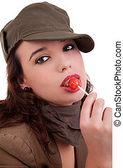 beautiful young woman with a lollipop isolated on white background. Studio shot.