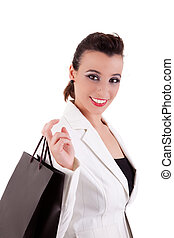 Happy woman with shopping bags, isolated on a white background. Studio shot.