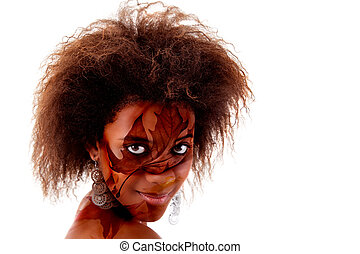 beautiful black woman, with autumn leaves painted on face, isolated on white. Studio shot.