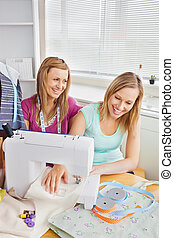 Animated female friends sewing clothes together at home in...