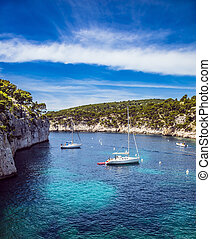 White boats waiting for tourists - National Park Calanques...