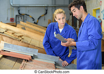 workers in carpentry workshop