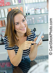 Woman enquiring about beauty product