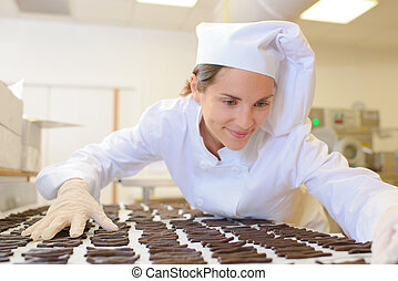Chef organising chocolates