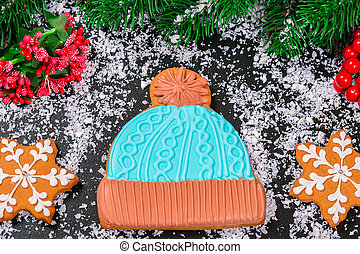 Beautiful Christmas gingerbread hat on a background of snow,...