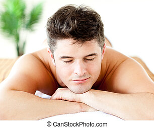 Portrait of an attractive man lying on a massage table