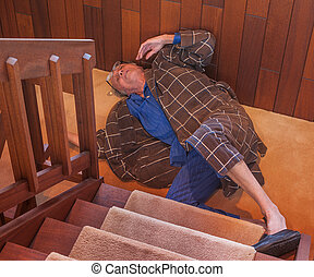 Senior man just fell down the stairs - A senior man trying...