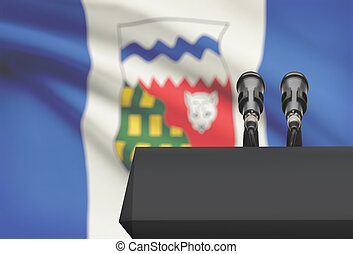 Pulpit and two microphones with Canadian province flag on...
