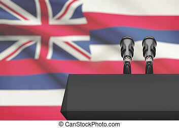 Pulpit and two microphones with USA state flag on background...