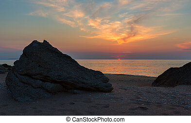 Sunset over the Sea of Azov on Generals beach. Karalar...