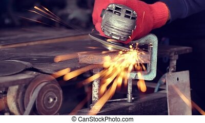 Angle grinder make a flash sparks - Hands working with angle...