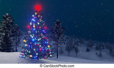 Outdoor decorated Christmas tree at snowfall night