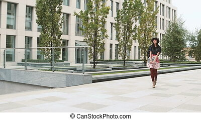 Asian student girl walking in city