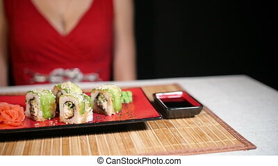 Woman Takes a Chopsticks - Woman in red dress takes a...