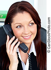 cute business woman on phone sitting in her office