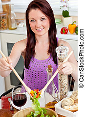 Cute woman eating her healthy meal at home